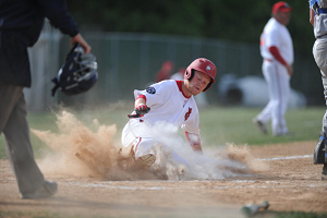 Photo courtesy of Bill Adams | The Express-Times. Jayson Mitch (9) slides into home, scoring the fifth run in the bottom of the second.